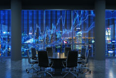Panoramic conference room in modern office, cityscape of New York skyscrapers at night, Manhattan. Stock Photos