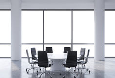 Panoramic conference room in modern office, copy space view from the windows. Black chairs and a white round table. 3D rendering Stock Photos
