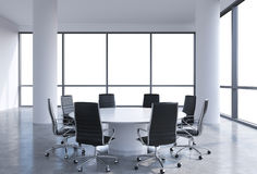 Panoramic conference room in modern office, copy space view from the windows. Black chairs and a white round table. Stock Photo