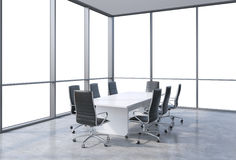 Panoramic conference room in modern office, copy space view from the windows. Black chairs and a white table. Stock Photos