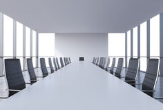 Panoramic conference room in modern office, copy space view from the windows. Black leather chairs and a white table. Stock Photo