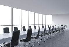 Panoramic conference room in modern office, copy space view from the windows. Black leather chairs and a white table. Stock Photos