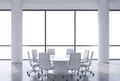 Panoramic conference room in modern office, copy space view from the windows. White chairs and a white round table. Stock Photo