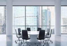 Panoramic conference room in modern office, Moscow International Business Center view. Black chairs and a white round table. 3D re Stock Photography