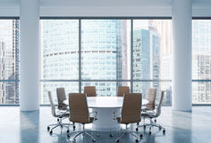 Panoramic conference room in modern office, Moscow International Business Center view. Brown chairs and a white round table. Stock Images