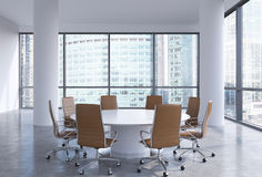 Panoramic conference room in modern office in Moscow, Russia. Brown chairs and a white round table. Royalty Free Stock Image