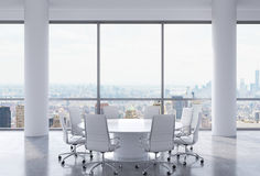 Panoramic conference room in modern office, New York city view. White chairs and a white round table. Stock Photo