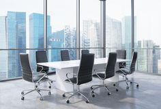 Panoramic conference room in modern office in Singapore. Black chairs and a white table. Stock Image