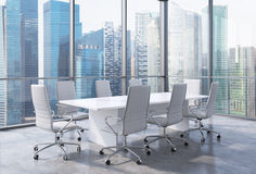 Panoramic conference room in modern office in Singapore. White chairs and a white table. Stock Photography