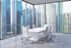 Panoramic corner conference room in modern office, Singaporean financial area view. White chairs and a white table. Royalty Free Stock Images