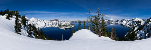 Panoramic of Crater Lake. With snow on a sunny day Royalty Free Stock Photo