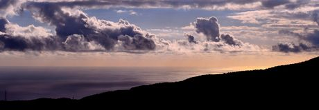 Panoramic at dawn with autumn clouds on the sea. Panoramic image at dawn with autumn clouds on the sea Royalty Free Stock Photo