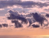 Panoramic dawn from the coast. With clouds and ship on the sea Stock Images