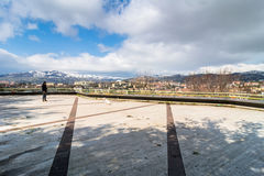 Panoramic day view of Potenza, Italy. POTENZA, ITALY - MARCH 13, 2015: unidentified person with dog, panoramic view of city and mountains in Potenza, Italy Royalty Free Stock Images