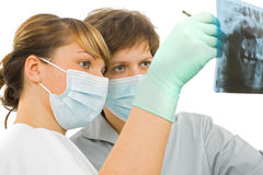 Panoramic dental Rx examine. Two sweet young doctor examine the dental Rx Stock Photography