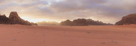 Panoramic desert landscape, Wadi Rum desert in Jordan at sunrise royalty free stock photo