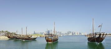 Panoramic dhows and Qatar skyline Stock Photos