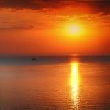 Panoramic dramatic sunset sky over sea at dusk Stock Photos