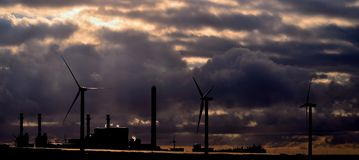 Panoramic  of electric power plant and wind turbines Royalty Free Stock Photography
