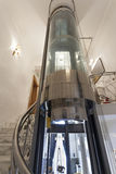 Panoramic elevator in atrium Stock Images