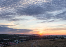 Panoramic evening landscape. With sunset and clouds receding into the distance telegraph poles Royalty Free Stock Image
