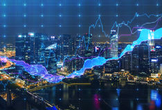 Panoramic evening New York view with the digital financial chart. A concept of the professional financial services Stock Images