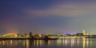 Panoramic evening view of the Dutch city of Nijmegen. With the flooded river Waal in front Royalty Free Stock Photography