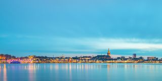 Panoramic evening view of the Dutch city of Nijmegen. With the flooded river Waal in front Stock Images