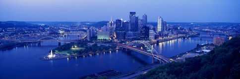 Panoramic evening view of Pittsburgh, PA with West End Bridge, and Allegheny, Monongahela and Ohio Rivers Royalty Free Stock Photos
