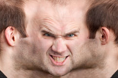 Panoramic face of malicious man. A panoramic face of very malicious man Royalty Free Stock Photography