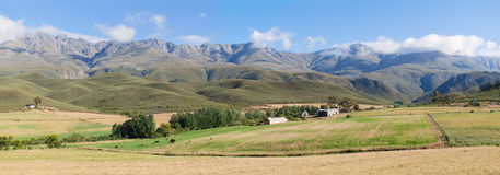 Panoramic farm landscape with high mountains and fields Royalty Free Stock Photos