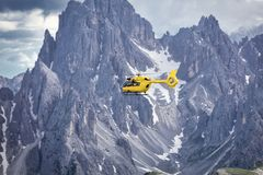 Panoramic flight over the mountains. Air transport. Stock Images