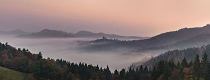 Panoramic foggy landscape at dawn over mountain and valley royalty free stock photo