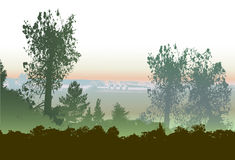 Panoramic forest landscape in the haze of mist and smoking chimneys Stock Photo