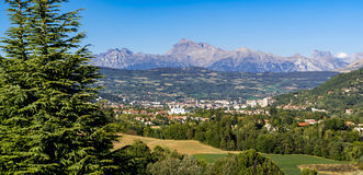 Panoramic of Gap, Hautes Alpes in Summer. French Alps, France. The Hautes Alpes city of Gap in Summer. Panoramic. Southern French Alps, France royalty free stock photography