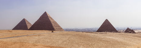 Panoramic Giza. A panoramic view of the Pyramids of Giza, Egypt Royalty Free Stock Photos
