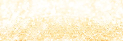Panoramic golden background of snow, holiday background. Panoramic golden background of snow, holiday glittering background royalty free stock photography