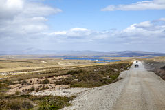 Panoramic Gravel road on East Falkland-2 Stock Photos