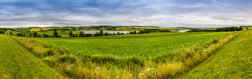 Panoramic. Hdr coutry view of a lake and fields in Prince Edward Island Canada Royalty Free Stock Photo