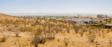 Panoramic high desert cityscape scenery. Beautiful panoramic shot of desert cityscape scenery, image taken at Apple Valley California showing the city of Apple Royalty Free Stock Photo