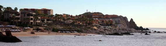 Panoramic high quality picture of luxurious Los Cabos Mexico rocky cliff ocean cost with luxury hotel and restaurants. With beach views during vacations Stock Photos