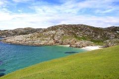 Panoramic highland scotland beach. Panoramic highland in scotland beach and grass Royalty Free Stock Images