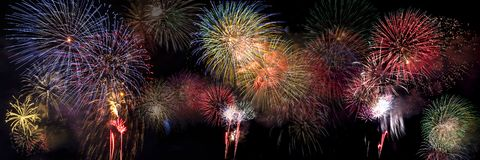 Colorful Fireworks Bursting in Night Sky royalty free stock images
