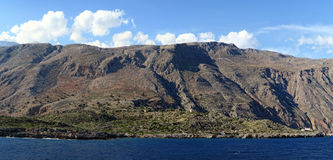 Panoramic image of Crete Greece mountains of Libyan Sea side. Driving with a boat along from Samaria gorge towards Loutro village. made of 4 images Stock Image