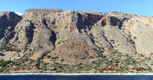 Panoramic image of Crete Greece mountains of Libyan Sea side. Driving with a boat along from Samaria gorge towards Loutro village. made of 5 images Stock Image