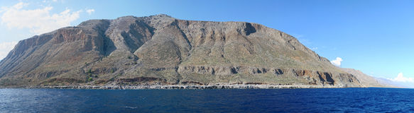 Panoramic image of Crete of Libyan Sea side. Panoramic image of Crete Greece mountains of Libyan Sea side. driving with a boat along from Samaria gorge towards Royalty Free Stock Photography
