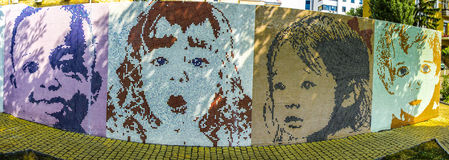 Panoramic photo of four children of persons of colored tiles Royalty Free Stock Photography