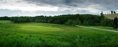 Panoramic golf course green, and lush grass royalty free stock photography