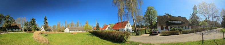 Panoramic image of historic group of houses, listed as monuments in Riems near Greifswald.  Royalty Free Stock Photo