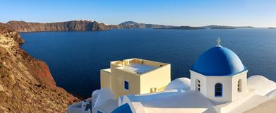 Panoramic image of local church with blue cupola in Oia on Santo Stock Image
